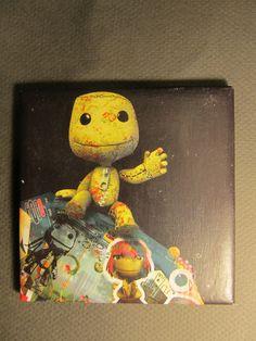 Unique handmade LittleBigPlanet ceramic coaster - Sack Boy and Sack Girl. $5.99, via Etsy.