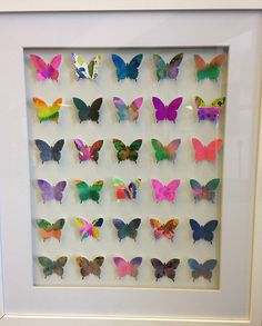 Butterflies class art project. Could do something similar, with a different shape, relating to their curriculum.