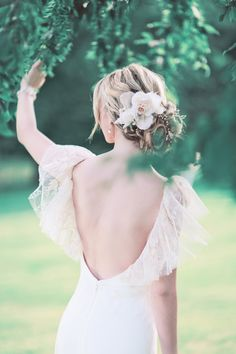 Glorious English Garden Wedding Inspiration at Ashdown Park | Daydreaming Bride. Loose bridal hair upstyle inspiration with flower