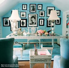 love the robin's egg blue wall with the black and white photos