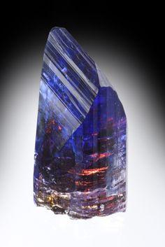 tanzanite...purple Zoisite. it almost looks like a sunset cityscape inside it.