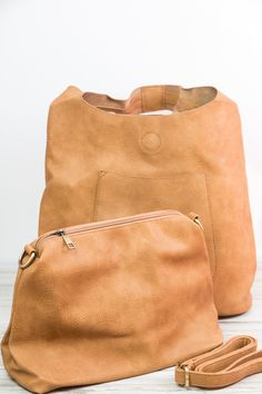 This soft and perfectly slouchy shoulder bag is great to carry all those daily…