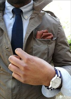 Go for an olive field jacket and a light blue longsleeve shirt for a casual level of dress.  Shop this look for $553:  http://lookastic.com/men/looks/watch-and-pocket-square-and-field-jacket-and-tie-and-longsleeve-shirt/3933  — Navy and White Canvas Watch  — Red Houndstooth Pocket Square  — Olive Field Jacket  — Navy Tie  — Light Blue Longsleeve Shirt
