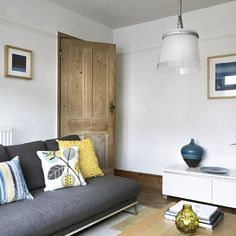 Living room with yellow and blue accents | Sofas | Cushions | housetohome.co.uk We have a grey sofa and I gloss white side for these stripped door looks interesting.