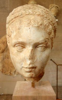 Marble portrait head of a woman  ca. 120-140 CE. Probably from Kenchreai.  Archaeological Museum of Ancient Corinth, Greece