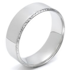 Gents Tacori 18 karat white gold band. The band has a high polished center with engraved edges.