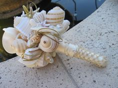 Sea shell bouquet on Etsy. Another thing I have-shells!
