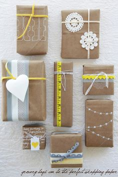 Brown paper bag wrappings. The bunting one would be adorable with twine and little fabric penants