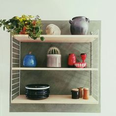 My string shelf with vintage goods and pottery. Retro