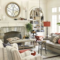 Large Mirror as the focal point above the mantle with two tall lamps flanking either side.  Could work with current set up.