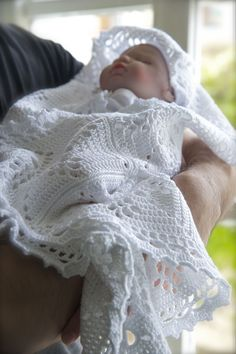 """""""Lace"""" is a handmade baby blanket. The soft cotton is crocheted in a Victorian style lace, perfect for embracing your baby during its christening."""