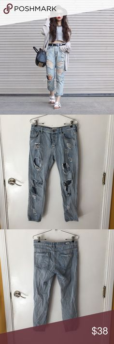 """Brandy Melville distressed boyfriend jeans -NWOT. Model pic is NOT mine. -The perfect light wash boyfriend jeans with distressing that doesn't look too factory made. Low rise with a 4 button closure. -Size 27, fits true to size but can fit a 28 for a skinnier fit. -No flaws. PRICE FIRM.   •waist (lying flat): 16"""" •hips: 19"""" •inseam: 25"""" •length: 34"""" •rise (from bottom of zipper): 7"""" Brandy Melville Jeans Boyfriend"""