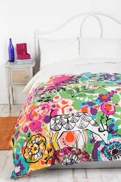 A splash of color in an all white bedroom is ideal to add some pop!  This Woodland Garden duvet cover has all the soft colors for spring with an earthy and artsy feel. urbanoutfitters.com