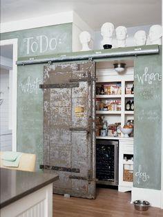 Handy chalkboard wall & space-saving pantry.