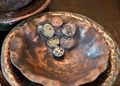 Love these bowls in her Home Collection with charms and stones inlaid.