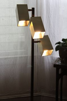 Koch & Lowy OMI Mid Century Modern Brass 3 Arm Floor Lamp. $289.00, via Etsy.