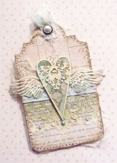 Love the ornate shape of the top of this beautiful shabby chic tag. #pastel #shabby #chic #pink #heart #wings #tag #handmade #crafts #paper #scrapbooking