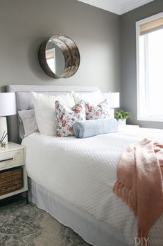 A Gray Guest Bedroom with Blush Accents Gray guest bedroom with blush accents. Love these floral pillows from HomeGoods to add a feminine touch and some color to this space. Dark Gray Bedroom, Gray Bedroom Walls, Blush Bedroom, Feminine Bedroom, Painted Bedroom Furniture, Modern Bedroom, Guest Bedroom Decor, Large Bedroom, Guest Bedrooms