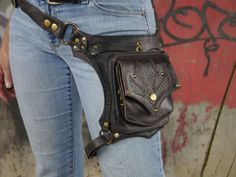 Chocolate and Antique Brass Steampunk Leather Holster Bag Utility Belt Bag. $145.00, via Etsy.