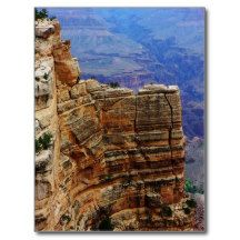 Sheer rock cliff face along the rim of Grand Canyon National park in Arizona. Grand Canyon scenery geology postcard. Photography from a local perspective by park employee Tammy Winand.