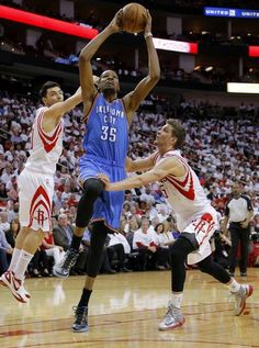 Oklahoma City's Kevin Durant (35) goes to the basket between Houston's Carlos Delfino (10) and Chandler Parsons (25) during Game 3 in the first round of the NBA playoffs between the Oklahoma City Thunder and the Houston Rockets at the Toyota Center in Houston, Texas, Sat., April 27, 2013. Photo by Bryan Terry, The Oklahoman