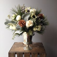 Winter white arrangement by Back Bay Florist