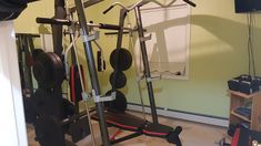 Read all about our home gym, cobbled together with Kijiji finds and secondhand scores. Proof that you can have the best on a shoe string budget. Ford Focus Hatchback, Half Rack, Olympic Weights, Old Mirrors, Project Ideas, Projects, Old Kitchen, Large Bedroom, At Home Gym