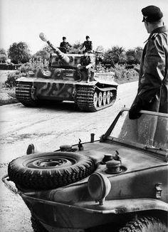 Panzerkampfwagen VI Tiger. Probably SS unit, since they have the Schwimwagon, amphibious Jeep.