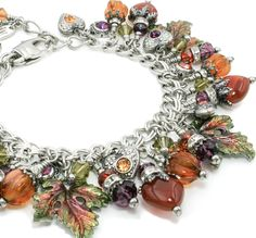 With the first flash of autumn, this autumn jewelry will make a statement for your fall jewelry collection, with five beautiful Carnelian stone hearts, radiant glass pumpkins, enameled leaves in coppe