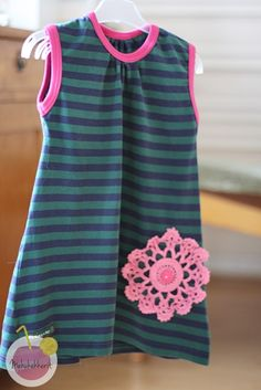 Dress made of old womens shirt. This is for a toddler.