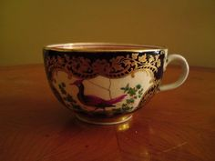 Antique 1920s Booths pottery tea cup scale blue birds flowers A/F