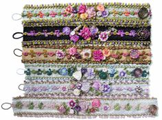 Bracelets made from ribbon. Decorated with pre-made ribbon flowers, charms and buttons.