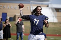 Steven Adams with the Oklahoma City Thunder throws a pass during a Heritage Hall football practice at the high school in in Oklahoma City, Wednesday, Sept. 14, 2016. Photo by Bryan Terry, The Oklahoman