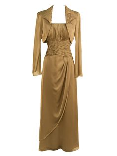 A flowing chiffon social occasion dress with a ruched bodice and spaghetti straps. Long slim a-line skirt. Added modesty with a long sleeve bolero jacket with ruched lapel.