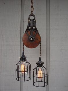 industrial pulley pendant lighting ideas for traditional room with spiral cable combine black iron shade and