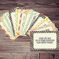 What a cute idea! Pick a questionnaire card each night for dinner to talk about each others day :)