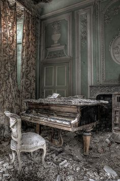 Drapes still up (hiding a window seat), paintings on the wall, piano waits for a player...why did everyone leave? What story could these walls tell?