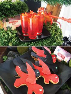 Dragon movie theme:How to Train Your Dragon Birthday Party Dessert Table -Red  black dragon cookies, dragon topped cupcakes  red fire dragon's breath Jello