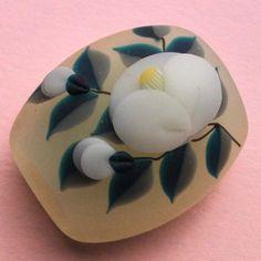 川北友果 : 帯留『白椿』white camellia on rock or bead I think. Japanese Textiles, Japanese Patterns, Japanese Fabric, Japanese Kimono, Cool Piercings, Traditional Japanese Art, Japanese Costume, Kimono Design, Japanese Outfits