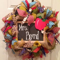 Wreath for back door.  Multi colored ribbon & chalk board with Baby Campbell written in blue & pink