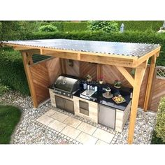 Self-built, covered outdoor stone kitchen with Napoleon built-in barbecue and kitchen.Self-built, covered outdoor stone kitchen with Napoleon built-in barbecue and hob // outdoor kitchen build ideas // selfmade outdoor kitchen out of st. Build Outdoor Kitchen, Outdoor Kitchen Countertops, Backyard Kitchen, Outdoor Kitchen Design, Backyard Patio, Diy Patio, Kitchen Cabinets, Island Kitchen, Kitchen Appliances
