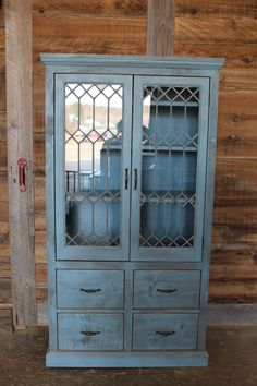 Piece of furniture made by Kimberley Jackson in Toronto and Huntsville, beautiful piece with an original leaded glass window as a door!
