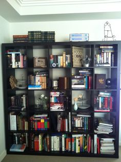 Melissa-Jane submitted to shareyourshelf:    They were ordered alphabetically by author but that is difficult to maintain when I am adding new books regularly.    The old must accommodate the new.