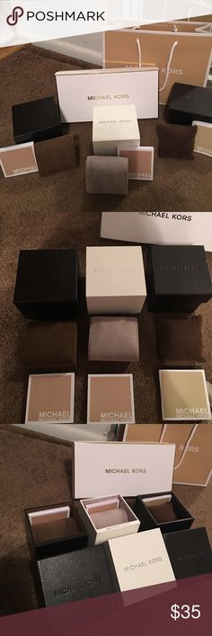 Michael Kors watch boxes, bag and wallet box Three authentic Michael Kors watch boxes, once small shopping bag and one wallet box. All watch boxes come with care instructions packets and pillow. Michael Kors Other