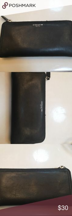 Authentic Coach Wallet Authentic black leather Coach wallet in great condition. Is very slight show of wear on back in corner but not very noticeable; otherwise in excellent condition. 8' wide. Offers are welcome Coach Bags Wallets