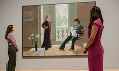 Getting the hang of it: two gallery assistants look at David Hockney's Mr and Mrs Clark and Percy as they prepare for his retrospective.