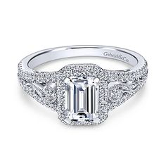 Intricate pavé diamond and milgrain details elevate the tapered band of this white gold halo engagement ring by Gabriel & Co. which showcases an emerald cut diamond. * Setting only - center diamond sold separately Emerald Cut Engagement, Halo Diamond Engagement Ring, Engagement Ring Settings, Emerald Cut Diamonds, White Gold Diamonds, Diamond Cuts, Round Diamonds, Bling Bling, White Gold Jewelry