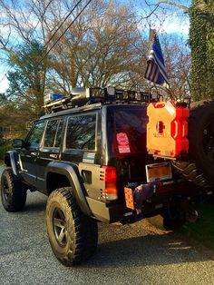 "'98 XJ. 6.5 inch Rough Country long arm lift, Riverraider snorkel, warn winch, 35"" Kumhos, Rubicon wheels, jcr armor, rockhard 4x4 rear bumper, custom front bumper, NotchCustom flares, Whelen & Code 3 lights, Superbright LEDs, rotopax cans, pro comp lights, lockers ,safari rack"
