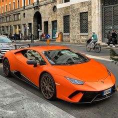 The Lamborghini Huracan was debuted at the 2014 Geneva Motor Show and went into production in the same year. The car Lamborghini's replacement to the Gallardo. The Huracan is available as a coupe and a spyder. Luxury Sports Cars, New Sports Cars, Exotic Sports Cars, Super Sport Cars, Exotic Cars, Lamborghini Huracan Orange, Lambo Huracan, Sports Cars Lamborghini, Lamborghini Lamborghini
