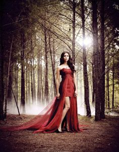 girl in forest red dress